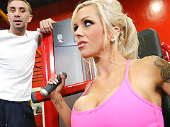 Nina Elle is a personal trainer who gets the best out of her clients for one very specific reason: she's hot as hell. So when Keiran starts getting tired halfway through his workout, she knows exactly how to motivate him. She pulls off her top to show off