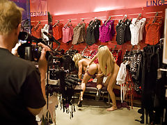 Blonde Lesbians using sex toys in a Lingerie store